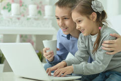 Children with laptop at home Stock Image