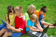 Children with laptops. Five children playing with laptops stock photography
