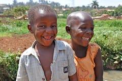 Children Laugh In Kampala Slums. KAMPALA, UGANDA, AFRICA - CIRCA JANUARY 2009:  Two unidentified children smile and laugh circa January 2009 in the slums of Stock Images