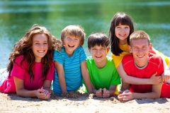 Children laughing by lake Stock Image
