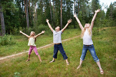 Children on lawn of forest and enjoy life in sports Stock Images