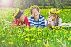 Children on lawn stock photos