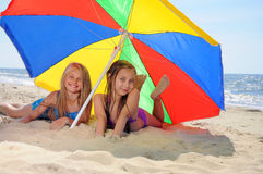 Children laying on beach Stock Photo
