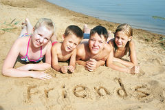 Children laying on the beach Stock Image