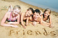 Children laying on the beach Royalty Free Stock Photography