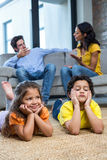 Children laying on the carpet in living room Royalty Free Stock Photo