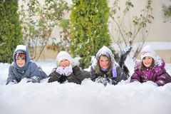 Children Laying On snow Royalty Free Stock Images