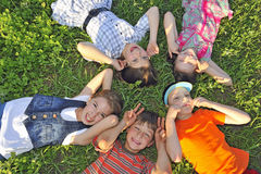 Children laying together on ground Stock Image