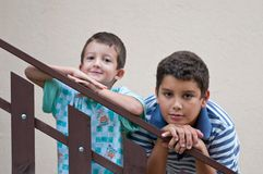 Children leaning against a railing Stock Photos