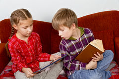 Children learn from the book readers and tablets Stock Photography