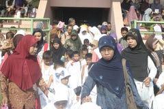 CHILDREN LEARN EARLY WORSHIP DRESS HAJJ HAJJ Stock Image