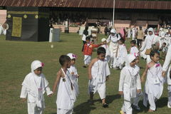 CHILDREN LEARN EARLY WORSHIP DRESS HAJJ HAJJ Stock Photo