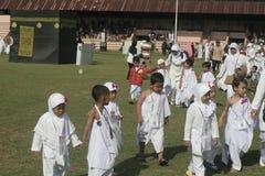 CHILDREN LEARN EARLY WORSHIP DRESS HAJJ HAJJ Stock Photo