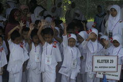 CHILDREN LEARN EARLY WORSHIP DRESS HAJJ HAJJ. Participants learn pilgrimage that followed an early age children with a white dress and veil type of ihram were Stock Photography