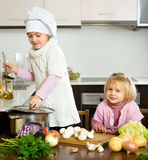 Children learn how to cook Stock Images