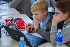 Children learn how to program a robot at Skolkovo Stock Images