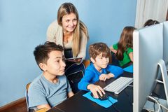 Children learn instruction in computer science. Children learn in computer science lessons of elementary school media literacy stock images