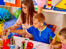 Children learn to draw in the kids club. royalty free stock photo