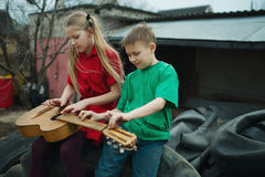 Children learn to play the guitar Stock Photography