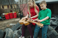 Children learn to play the guitar Stock Photos
