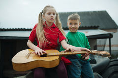 Children learn to play the guitar Royalty Free Stock Photo