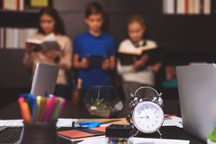 Children learning actively despite late hour royalty free stock photo