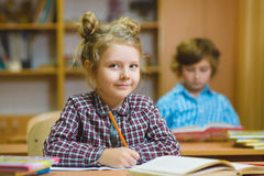 Children learning and doing homework in school classroom royalty free stock photography