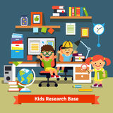 Children learning and doing projects in their room Stock Image
