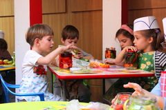 Children learning how to pickle. At kindergarten in Bucharest,Romania Stock Photos