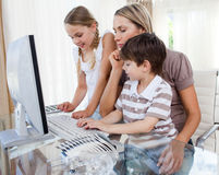 Children learning how to use a computer Stock Images
