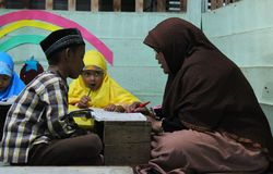 Children are learning to read al quran in the TPA. With a teacher, meulaboh Aceh Barat Royalty Free Stock Photo
