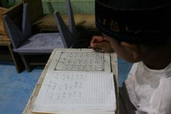 Children are learning to read al quran in the TPA. With a teacher, meulaboh Aceh Barat Stock Photo