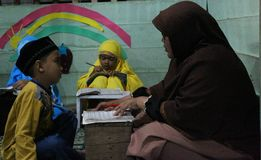 Children are learning to read al quran in the TPA. With a teacher, meulaboh Aceh Barat Royalty Free Stock Photos