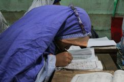 Children are learning to read al quran in the TPA. With a teacher, meulaboh Aceh Barat Royalty Free Stock Images