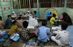 Children are learning to read al quran in the TPA. With a teacher, meulaboh Aceh Barat Stock Photography