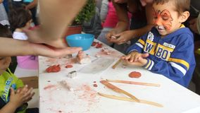 Children learning to shape plasticine stock footage