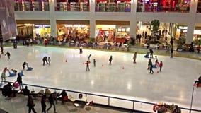 Children Learning To Skate On Skating Ring Interior stock video