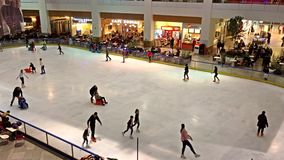 Children Learning To Skate On Skating Ring Interior stock footage