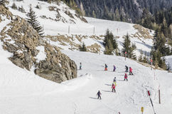 Children learning to ski. On a beginners slope in Sinaia, Bucegi Mountains, Romania Stock Photos
