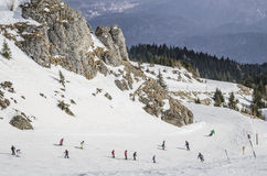 Children learning to ski. On a beginners slope in Sinaia, Bucegi Mountains, Romania Stock Images