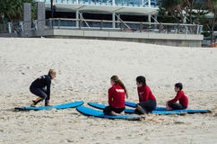 Children learning to surf in Surfers Paradise. Royalty Free Stock Photos