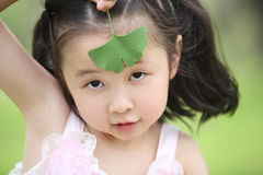 Children and leaves Royalty Free Stock Photo