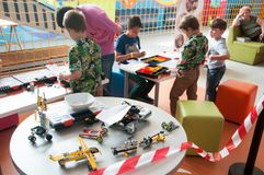 Children at the Lego robotics workshop. Children creating robots at the Lego robotics workshop Royalty Free Stock Photos