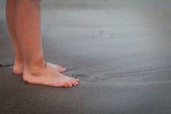 Children legs on a beach Stock Photography