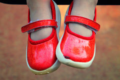 Children legs in red shoes Stock Photos