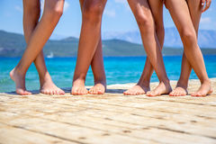 Children legs on the wooden pier Royalty Free Stock Photo