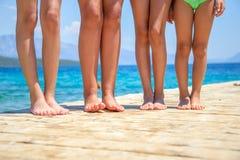 Children legs on the wooden pier Stock Image