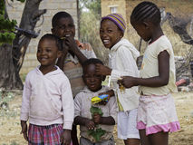 CHILDREN_LESOTHO. A group of children smile near their home in Maseru, Lesotho in southern Africa Stock Image