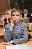 Children at a lesson. The schoolboy at a lesson sits at a school desk Royalty Free Stock Images