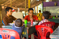Children in lesson at school by project Cambodian Kids Care. KOH CHANG, THAILAND - FEB 8, 2016: Unidentified children in the classroom at lunch time at school by Royalty Free Stock Image